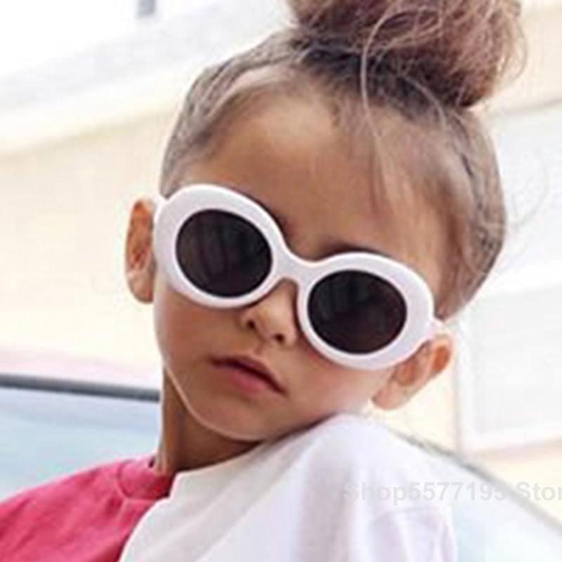 Niños lindo marco óptico de los vidrios del niño oval colores puros cumpleaños Decoración de fiesta de los niños Fantasía Infantil 2020 gafas de sol