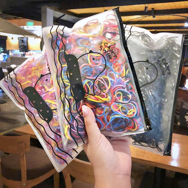 Bandas de banda para el cabello 1000pcs / color del caramelo bolsa de goma de los niños Cuerdas Sweet Girls Cola de caballo Hodler niños Accesorios para el cabello