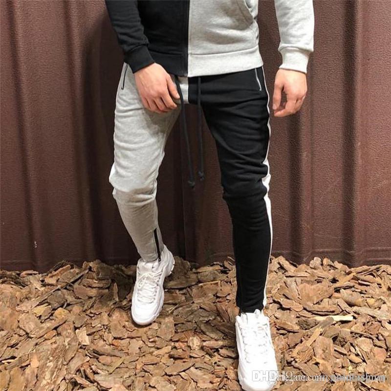 Sirve de contraste de color con paneles pantalones forman los pantalones del hombre con el diseñador de la cremallera delgada ocasional del deporte de rayas ropa