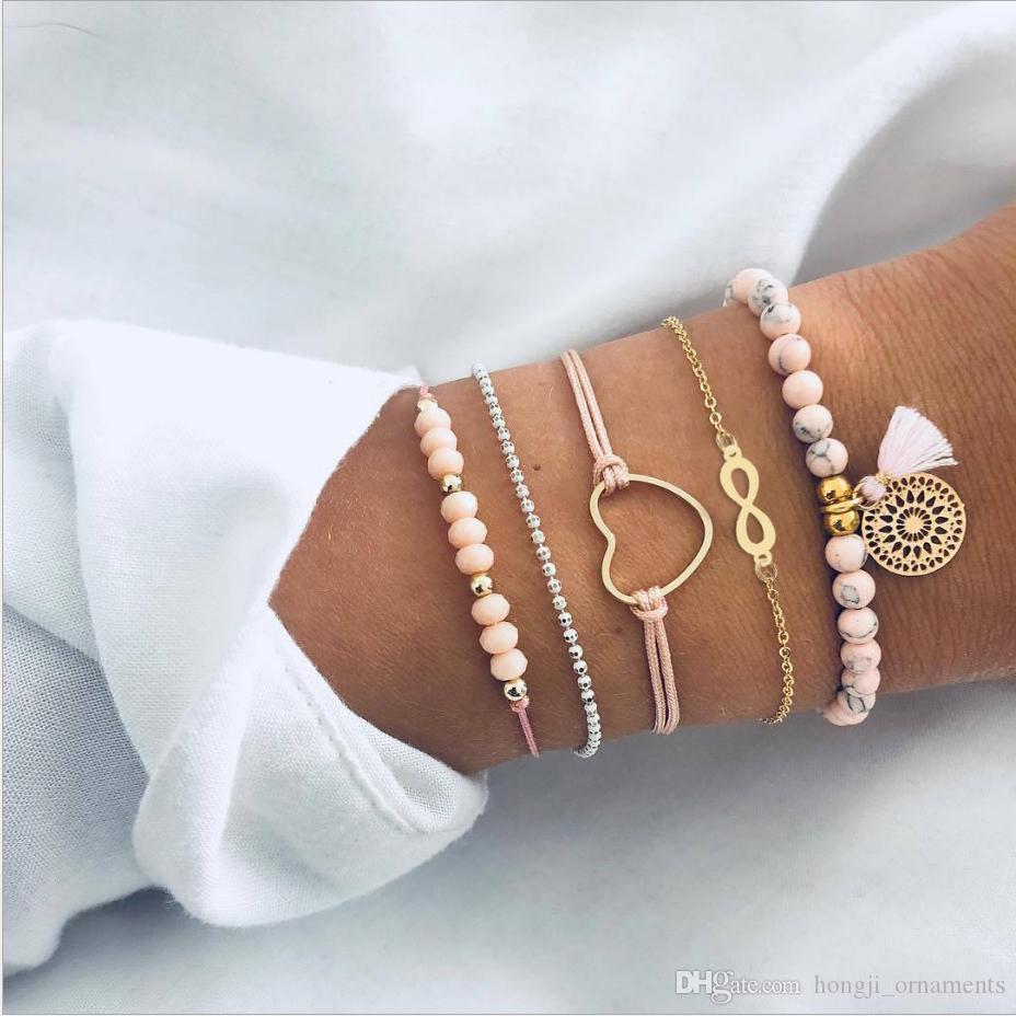 Braccialetti set 5pcs / set branello rosa trefoli cuore 8 ancoraggio colore stringa fascino accessorio fiocco oro catena del branello placcato disco cavo-out