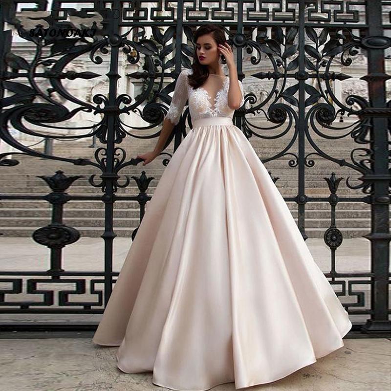Robe élégante en dentelle de mariage Vestidos de novia 2020 Champagne Une ligne robe de mariée en satin sexy romantique étage Longueur Robes de mariée