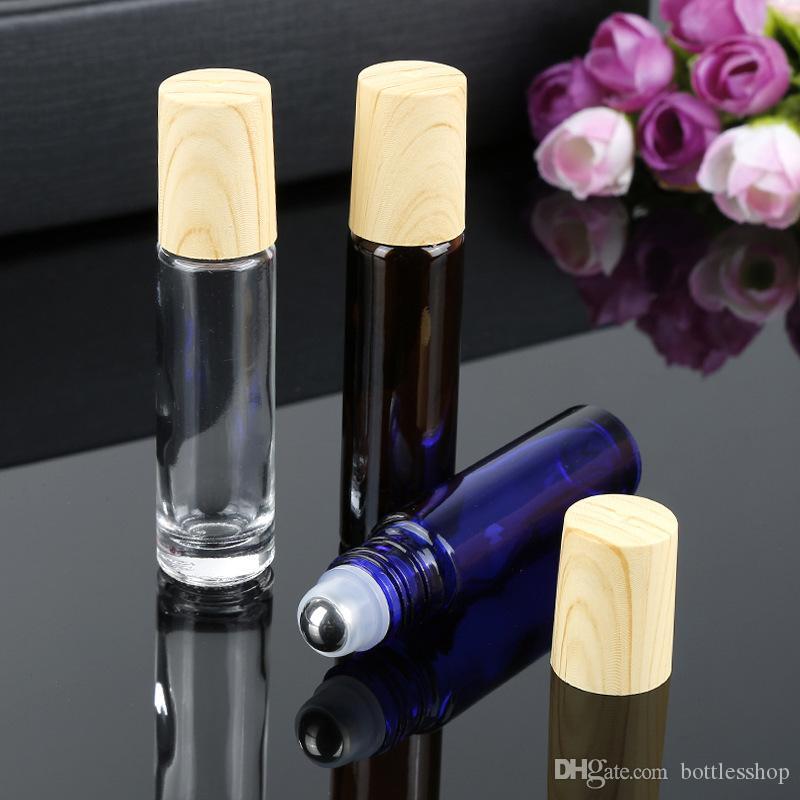10ml Ambre Bleu Huile Essentielle verre rouleau bouteilles rouleau sur bouteille de parfum avec grain de bois en plastique Caps en gros 600pcs / lot