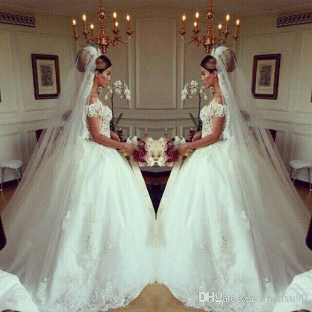 Árabe 2019 Vestidos de novia Vestidos de novia de encaje Princesa Vestido de bola Pura Gorra de cuello redondo Mangas botón cubierto Corte de tren Vestidos de boda