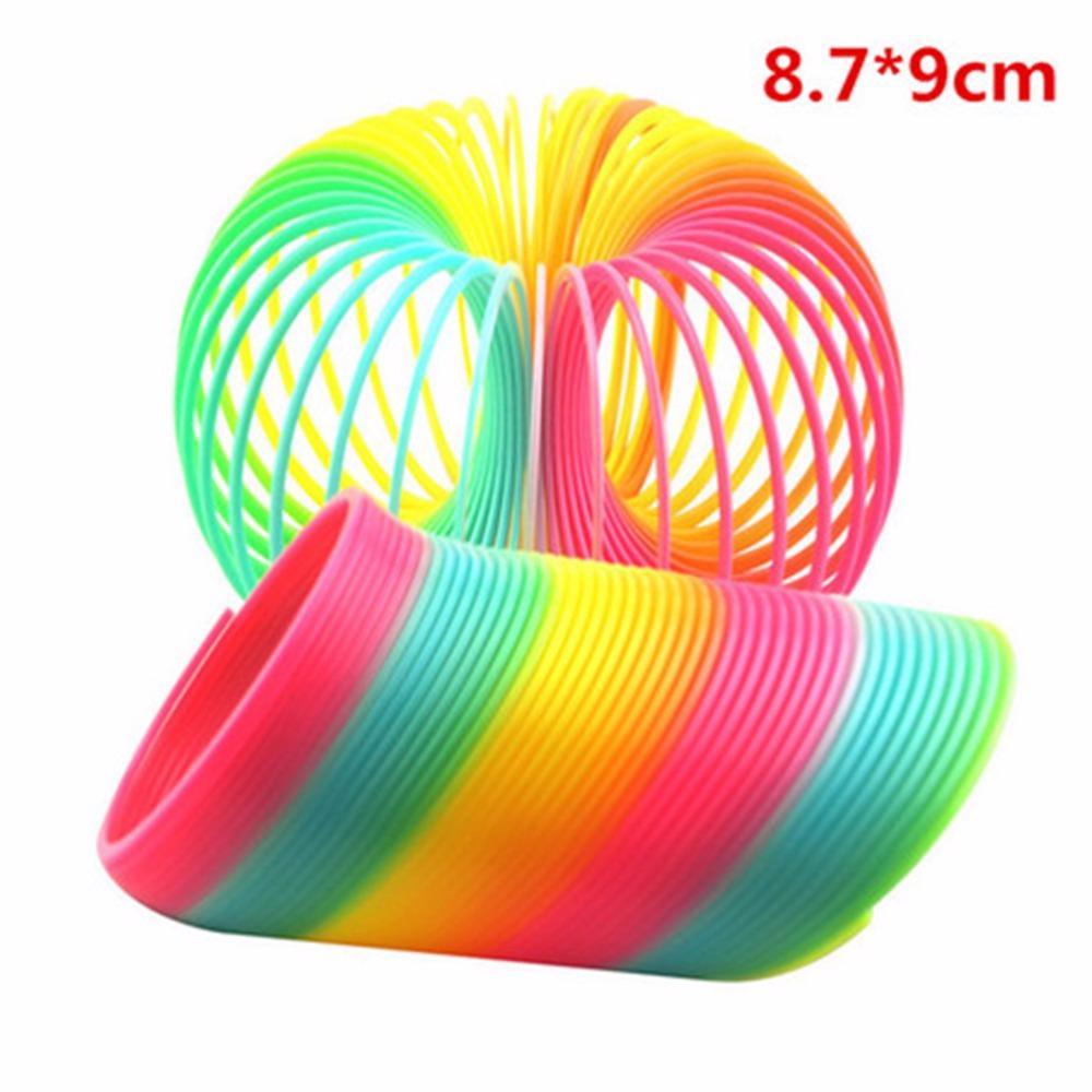 Colorido juguete clásico divertido para los niños regalo de la venta caliente grande mágico plástico Slinky Rainbow Spring Kids Toy 8.7 * 9 cm