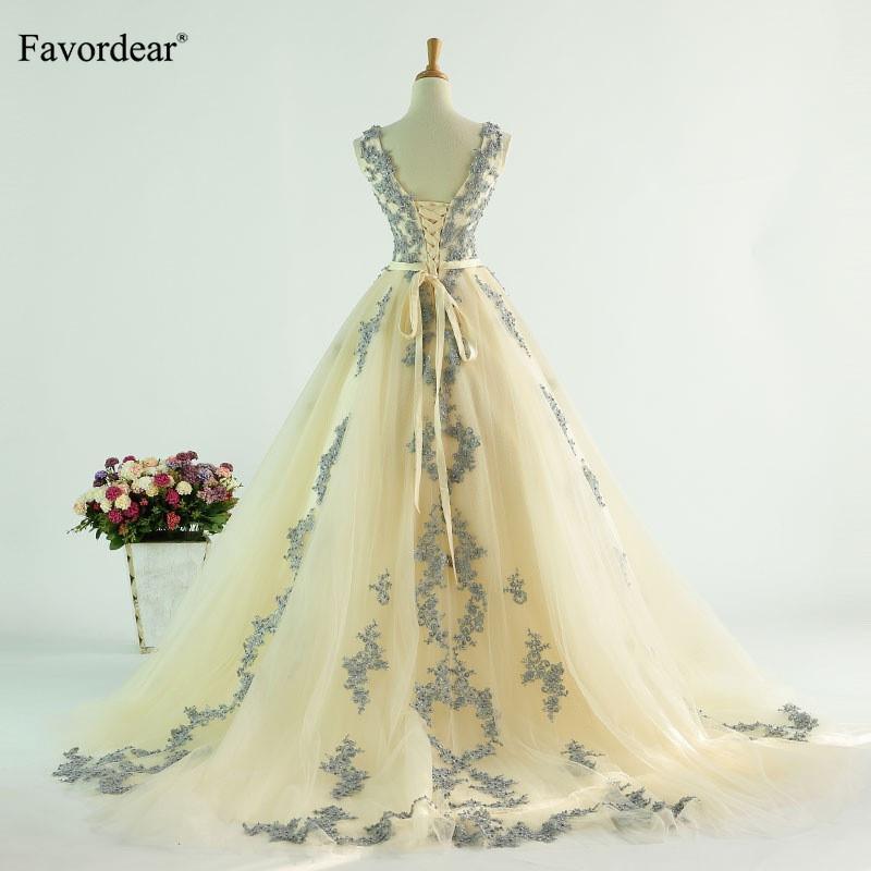 Venta al por mayor 2019 Nueva Alta Calidad Luz Champagne Applique con cuello en v vestido de novia Vestido De Noiva Princesa Vestido de novia con Fajas
