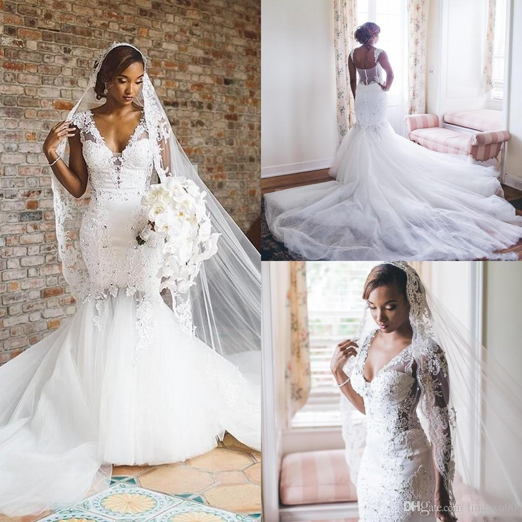 Robes de mariée de sirène africaine 2019 avec des perles Appliqued robe de mariée en dentelle Deep V Neck Capped Sleeve Custom Made Sexy Retour robes de mariée
