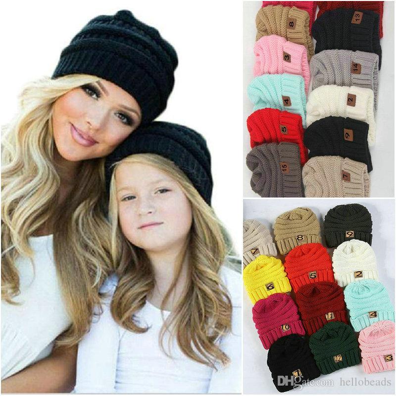 Las mujeres guardan los niños cálido invierno de la gorrita tejida de lana sombreros de etiquetado cráneo Gorro de lana diseñador de gorras deportivas al aire libre para los niños del bebé muchacho 2018 de la moda