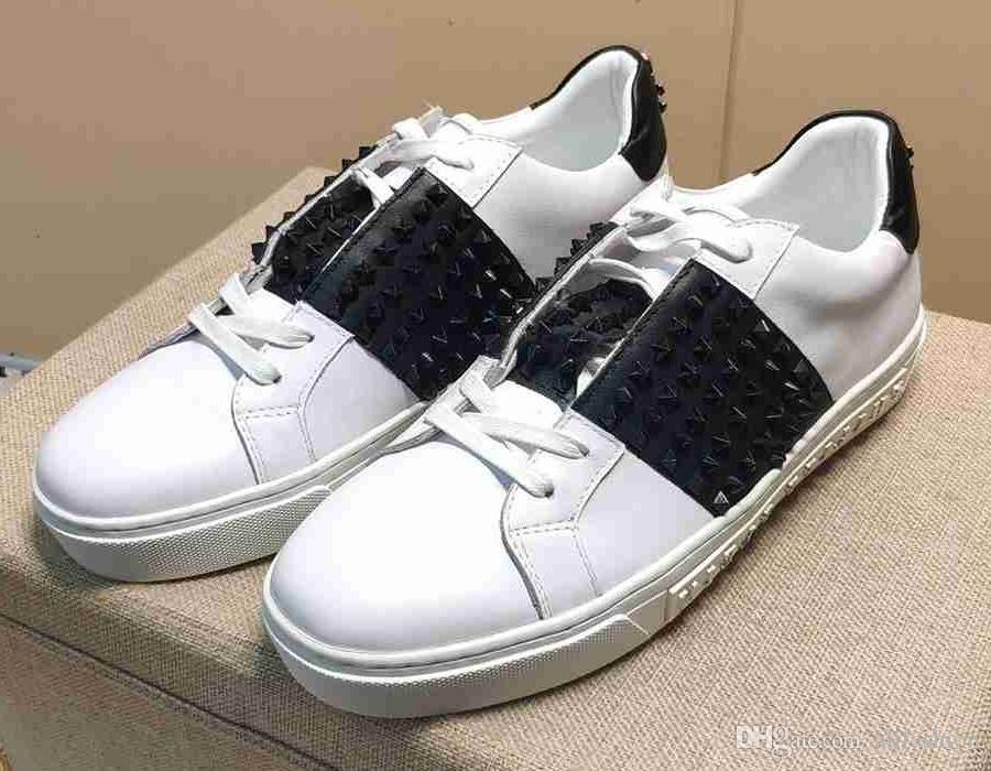 Chaussure de skate en cuir de vache de marque hommes baskets de sport de baskets plates de haut en métal de dessus de crâne baskets de mode de crâne Mocassins rue Casual chaussure blanche, 38-44