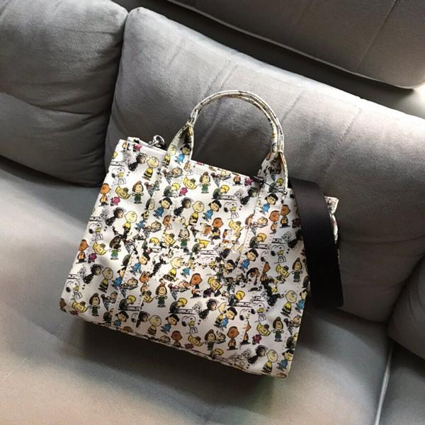 La primavera e l'estate 2020 nuova tela di canapa a banda larga shopping bag bag nuovo modo di tendenza retrò portatile delle donne versatile sacco per cadaveri trasversale coreano
