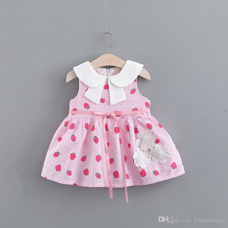 Le ragazze di estate 2019 vestono l'usura dei bambini a strisce stampata fragola di colore solido all'ingrosso