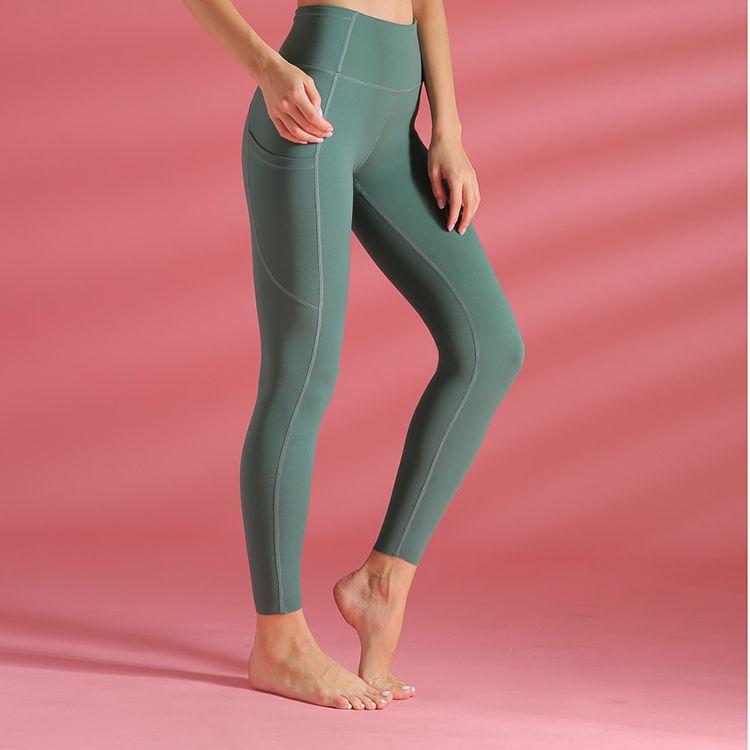 Nuevo tramo delgado de cintura alta de la cadera de la cadera de yoga pantalones deportivos de nylon de doble cara hembra medias pantalones de fitness europeas y las polainas de las mujeres