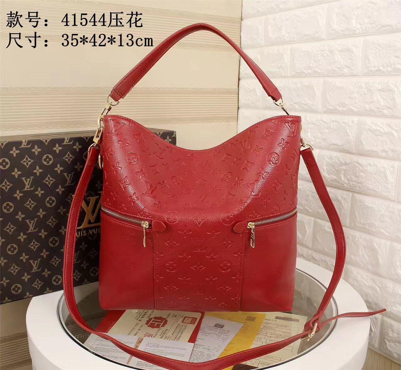 With metal engraved zipper head women's high quality fashionable personalized Slanting handbags 022004