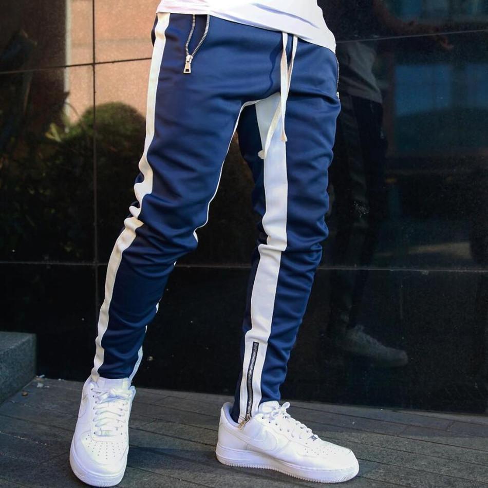 Mens Jogadores Calças Casuais Fitness Homens Sportswear Tracksuit Bottoms Skinny Sweatpants Calças Preto Gyms Jogger Pants Calças Y200518