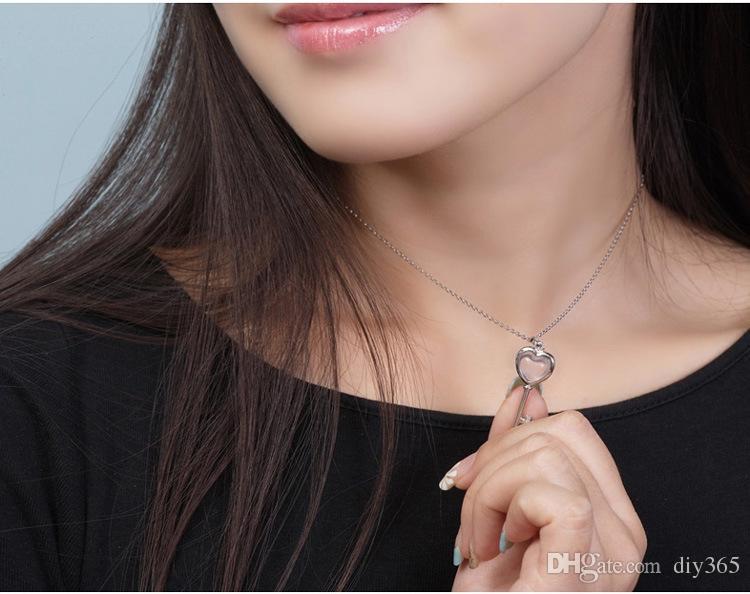 Оптовая женщин темперамент ожерелье кулон женский новый счастливый ключ гибискус порошок Кристалл кулон посеребренные (не содержат цепи)
