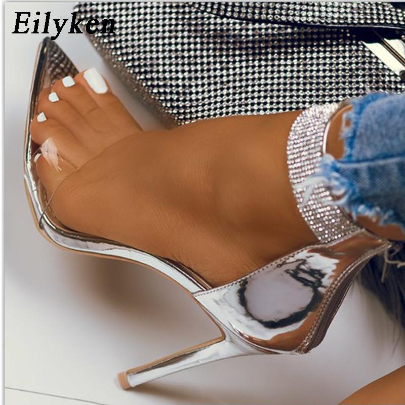Eilyken 2020 Sommer-neue Kristallknöchelriemen-Sandalen Frauen-reizvolle geöffnete Zehe PVC Zipper dünner High Heels Sandaletten Weibliche Hochzeit Schuhe CX200610