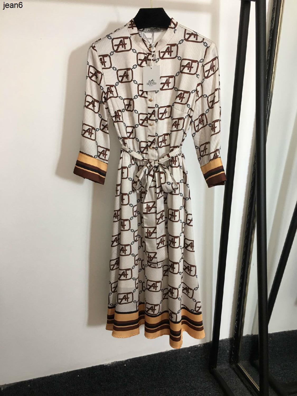 Nueva tienda delgada personalidad mejor carta de punto de impresión de encaje sola fila hebilla de oro hasta la pretina de pie cuello de vestir de manga Siete-040505