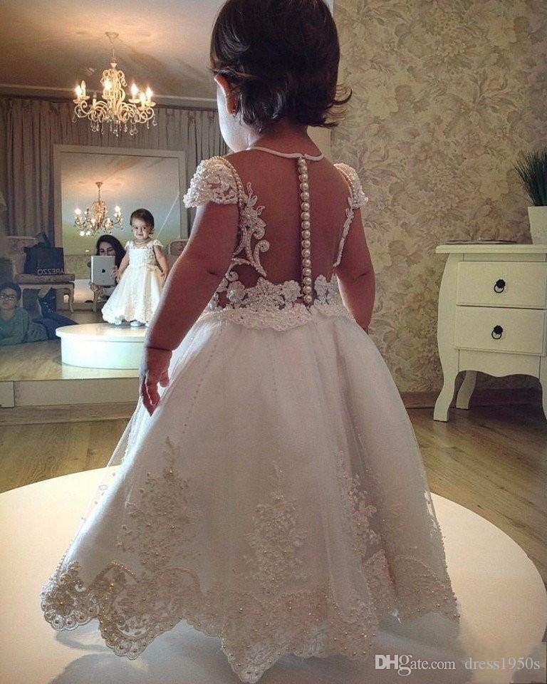 2019 Vestidos de niña de flores para bodas Una línea de gorro Mangas Tul Apliques Perlas Vestidos largos de primera comunión para niñas