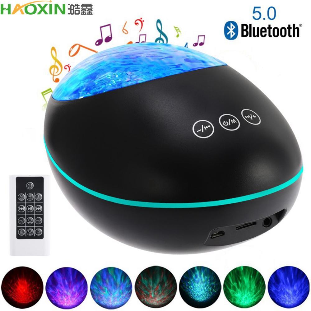 Haxin Night Light Projector con lettore musicale Bluetooth 5.0 Pietra fortunata Ocean Wave Projector 12 LED 8 colori Telecomando a distanza