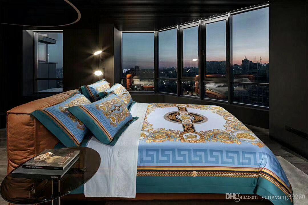 وضع 100S القطن الطراز الأوروبي فاخر المصرية الذهب الأزرق الملك محفظة 5pcs الفراش غطاء لحاف السرير تنورة سادات تصميم العلامة التجارية رسالة