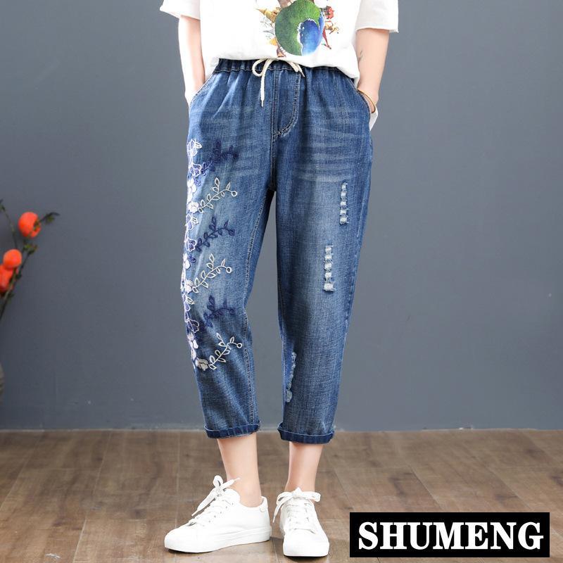 2020 Nouveau Plus Size Casual Jeans d'été Vêtements pour femmes à taille élastique en vrac Fleurs Broderie Denim Pantalons veau-longueur Pantalons