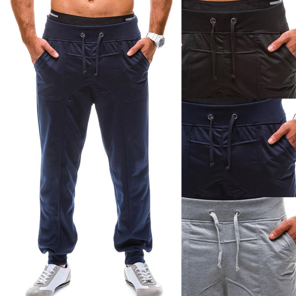 Marque Hommes Pantalons Hip Hop Harem Joggers Mode Pantalons Décontractés Hommes Couleur Pure Tethers Poche Ceintures Élastiques Loose Sports Z314
