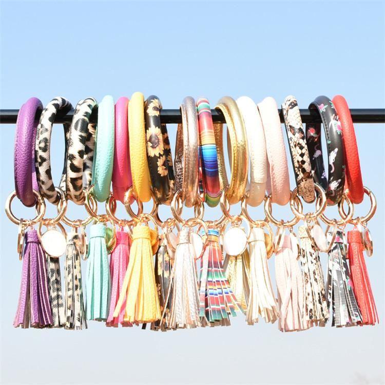 Frauen Quasten Armbänder PU-Leder-Verpackungs-Schlüsselring-Leopard-Lilien-Druck Keychain Armband Sonnenblume Drip Öl Kreis-Armband-Anhänger Armband