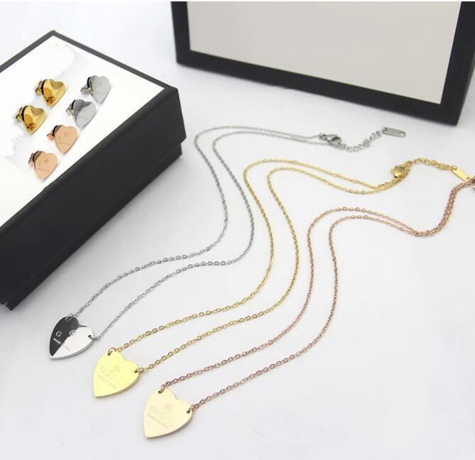 Gioielli Europa America modo fissa d'acciaio della signora di titanio Insiemi 18 carati placcato oro degli orecchini delle collane con cuore pendente Lettera G