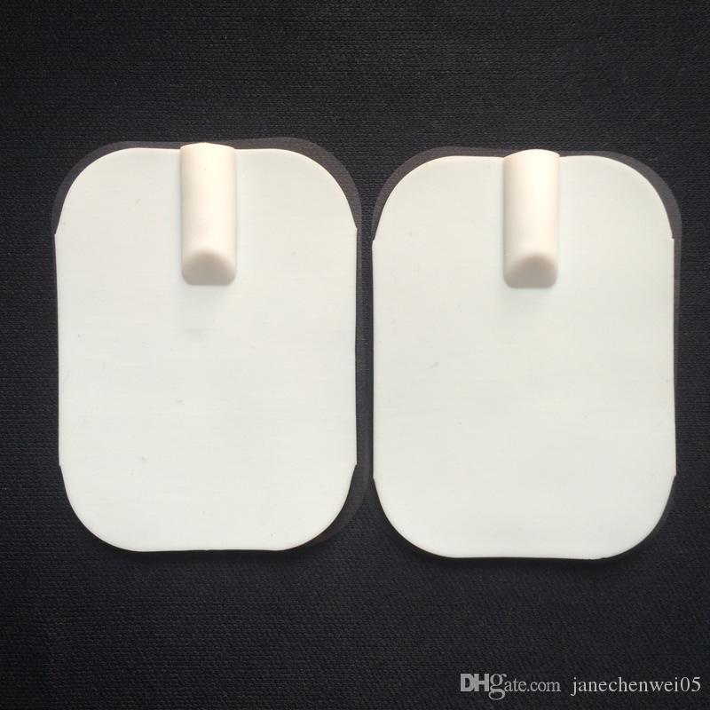Tampon d'électrode auto-adhésif TENS / EMS 4.5 * 6cm (1.8 * 2.4inch) avec trou (2mm) Tampons d'électrode en caoutchouc de silicium