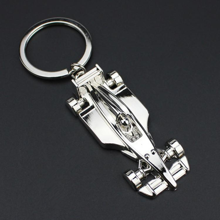 100pcs / lot Nuevo Metal 3D Racing Car Llaveros de aleación de zinc de carreras de coches Llaveros de regalos de los hombres