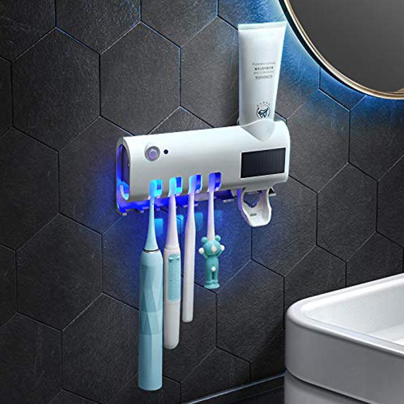 venta al por mayor del cepillo de dientes esterilizador UV recargable de energía solar LED Desinfección montado en la pared cepillo de dientes titular de extrusión de pasta de dientes automático