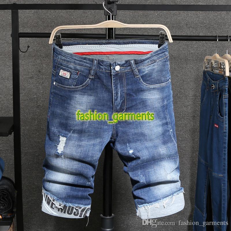 La moda de Nueva verano Agujero pantalones cortos de mezclilla para hombre de la moda de estiramiento delgados pantalones cortos para hombre de personalidad Cuffed vaqueros para hombre Pantalones cortos estilista