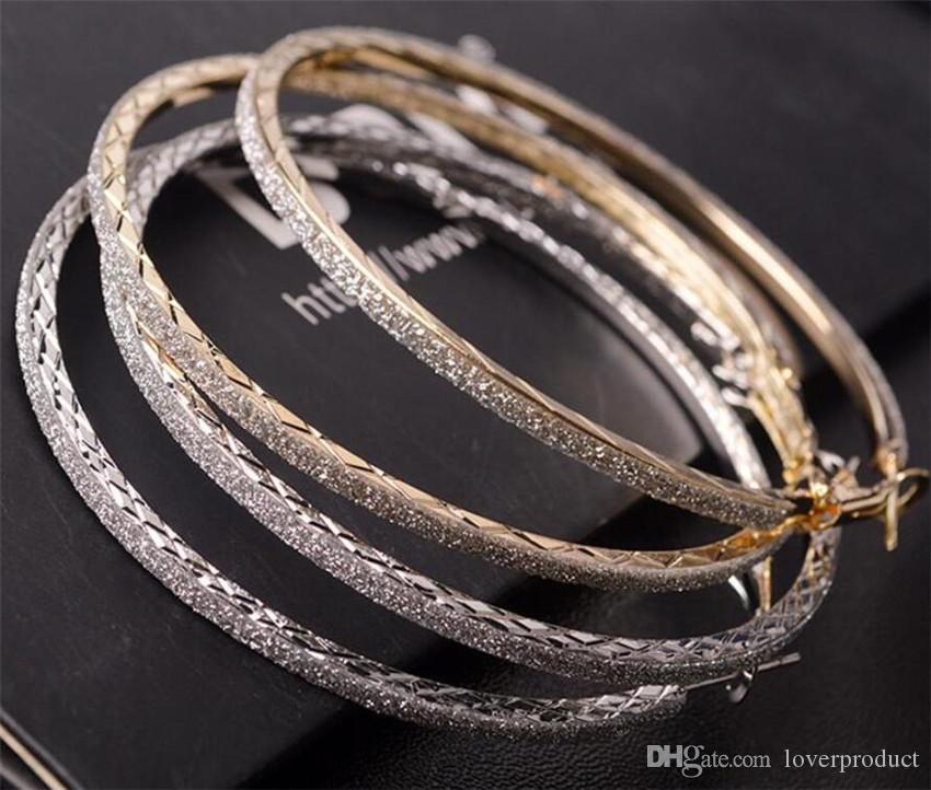Nouveau produit unique Femmes Mode Bijoux Boucles d'oreilles Argent Décoration alliage d'or Boucles d'oreilles
