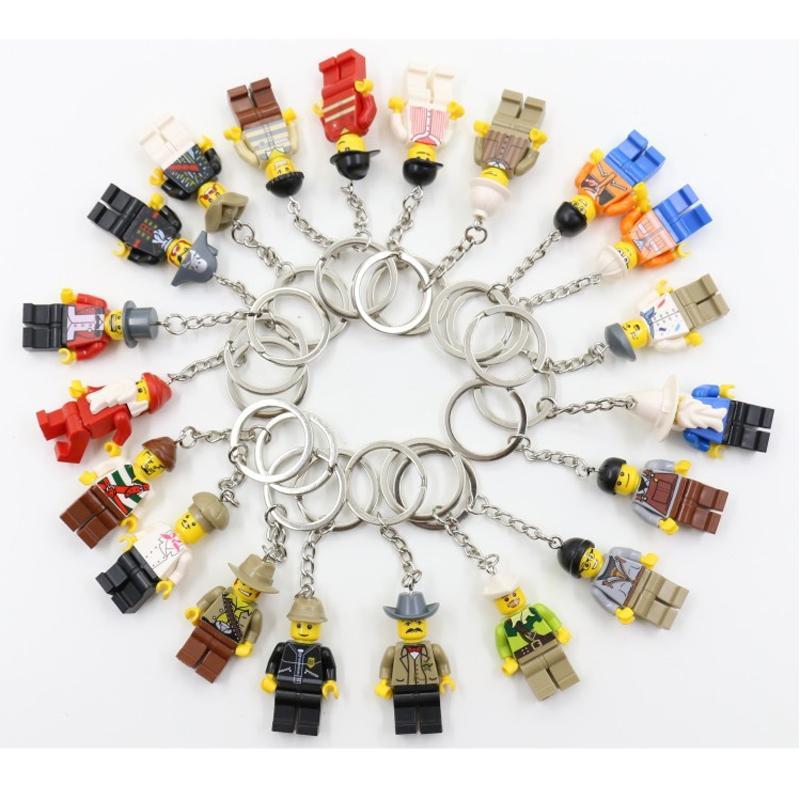 100pcs / porción mezclada 20 estilos del anillo dominante del bloque juguetes muñecas de la historieta llavero Llavero Bloque de construcción de juguete llavero Niños