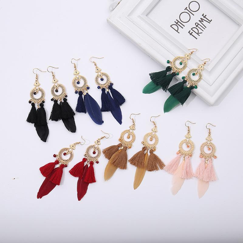 European and American simple rice beads tassel feather earrings female wild drip retro earrings small commodity wholesale