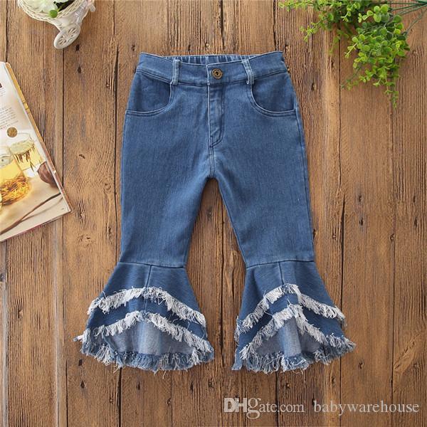 Baby-Kleidung Mode-elastische Taille Flare Jeans mit weitem Bein und Quaste Hosen Kinder lose Hosen-Denim-Hosen-Kleinkind-Kind-Mädchen-Jeans 2-7T