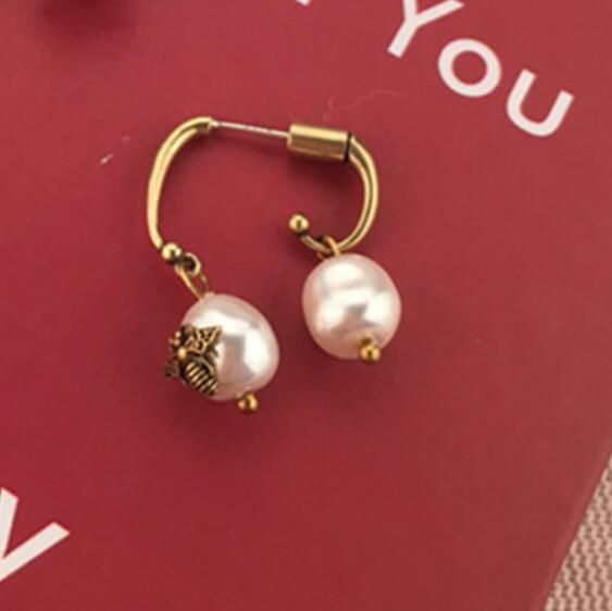 Joyería de lujo S925 plata esterlina aguja perla irregularidad pendientes de metal clásico para las mujeres moda caliente
