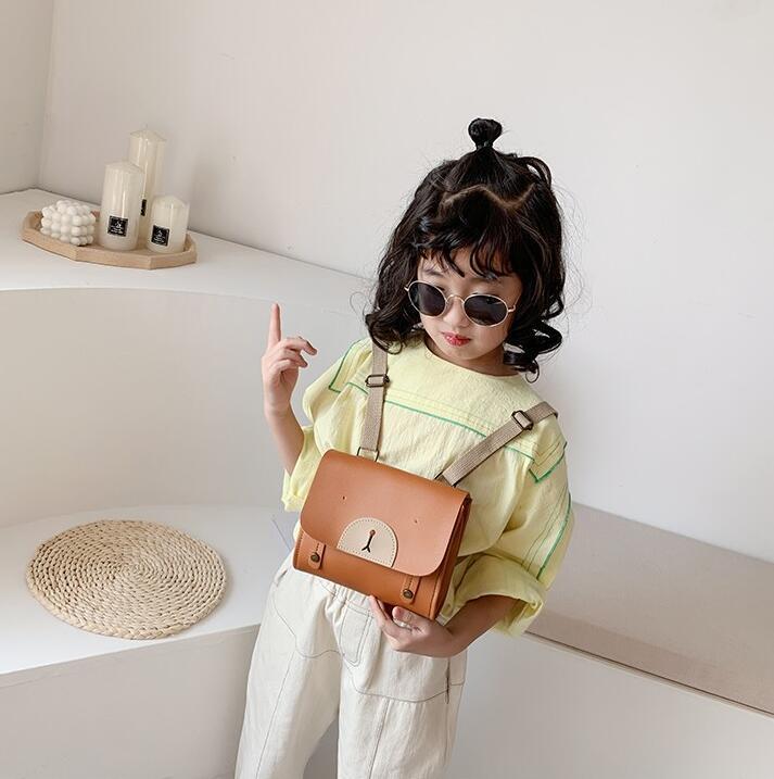 Neue Art und Weise Baby-Rucksäcke Mini netten Handtaschen-Qualitäts-Mädchen-Schulter-Beutel-Karikatur Kleiner Rucksack