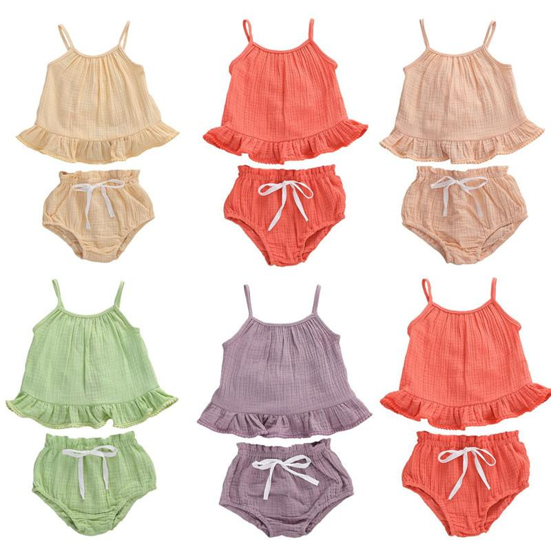 Infantiles bebés de los muchachos arropa sistemas 0-24 M recién nacido sin mangas del chaleco de las tapas del juego + pantalones cortos de algodón Ropa de bebé de 5 colores sólidos Equipos