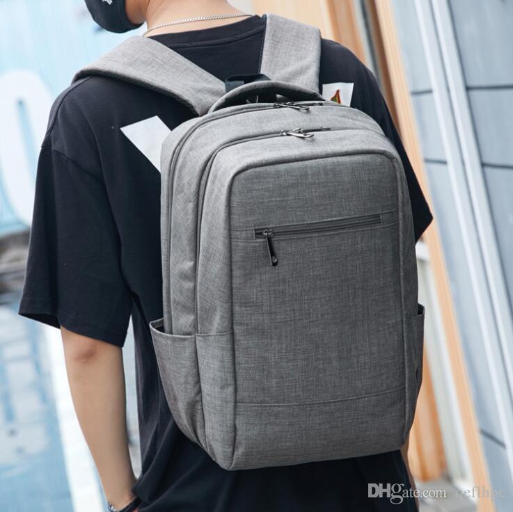 2020 Sac à dos en gros Sports Voyage hommes et sacs de femmes Cartable durables 14 pouces paquet d'ordinateur Gris Noir Bleu 607