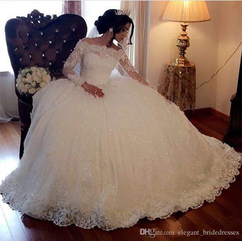 Robe de bille dentelle robes de mariée 2018 manches longues à manches longues d'épaule Appliques de paillettes Puffy Arabe Dubaï Church Robes de mariée Plus Taille