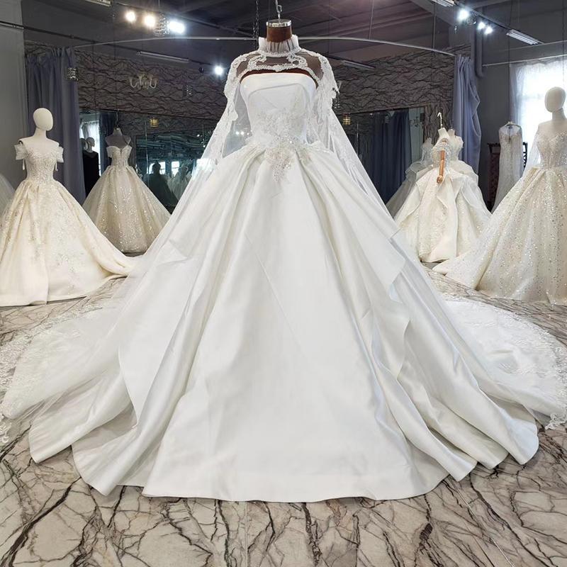 2020 Robe de mariée manches Lastest Cape pailletée Stain robe de bal lacé dans le dos Appliques perles de luxe Blanc Nouvelle robe de mariée Dernière
