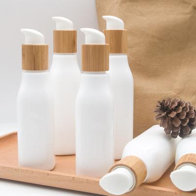 Bamboo lotion cap cream spray bottle 120ml 100ml 4oz glass Opal White Porcelain Glass Pump Bottle Bamboo Cosmetic Containers