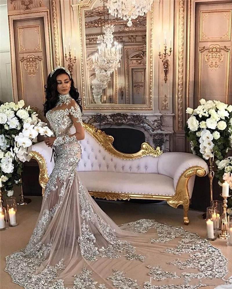 Vestido de boda del tren de lujo árabe Dubai cuello alto de sirena de la boda de plata con cuentas de manga larga de la ilusión de encaje sin respaldo Corte apliques