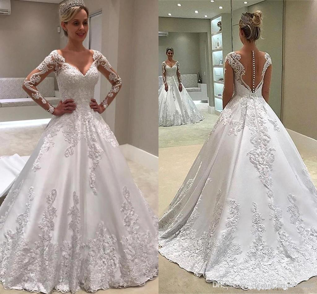 Modest White Long Sleeve A Line Vestidos de novia Sheer Backless con botones Jewel Neck Appliques Vestidos largos Vestidos de novia