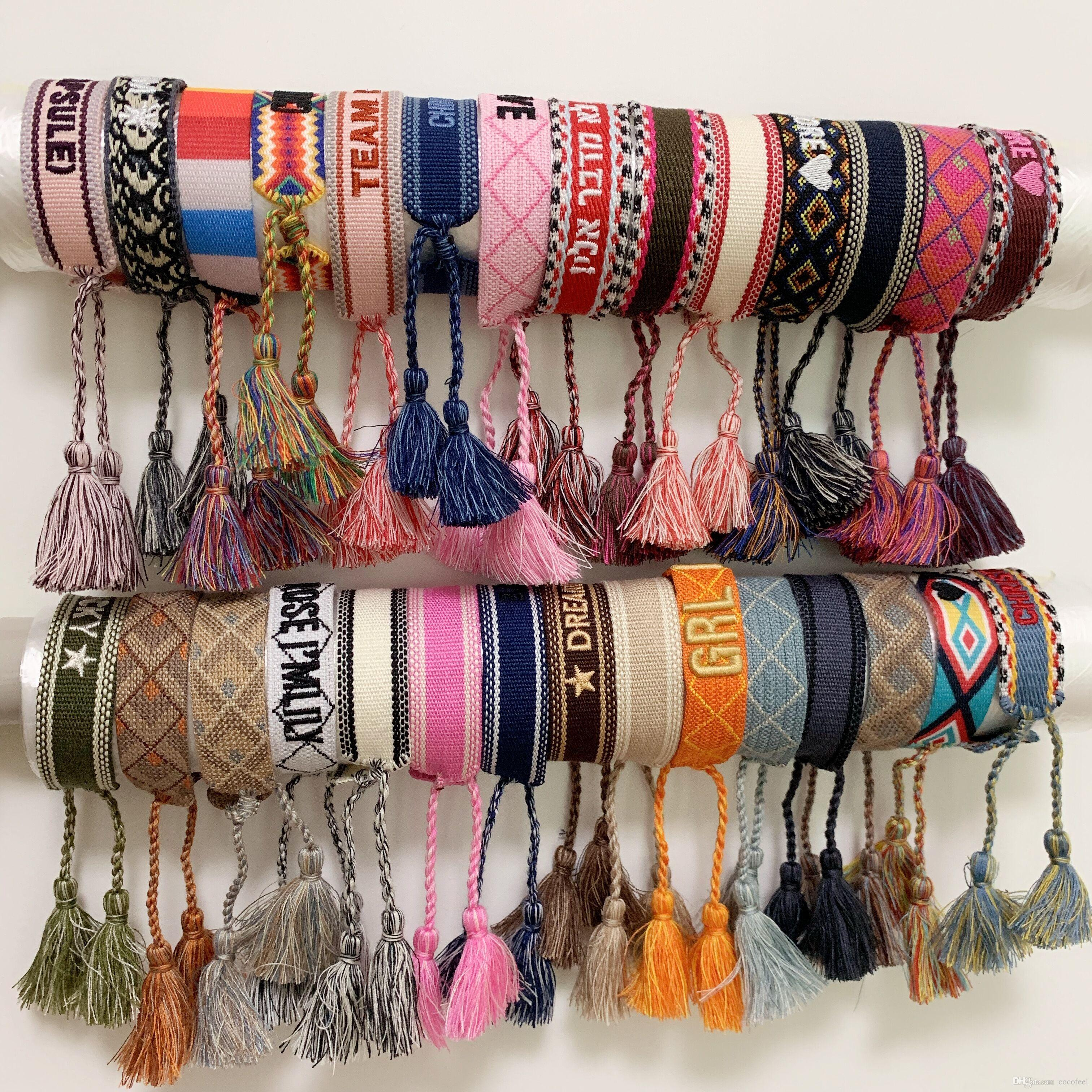 Luxury style rope material woven bracelet with sewing words and tassel hand strap brand jewelry for women gift