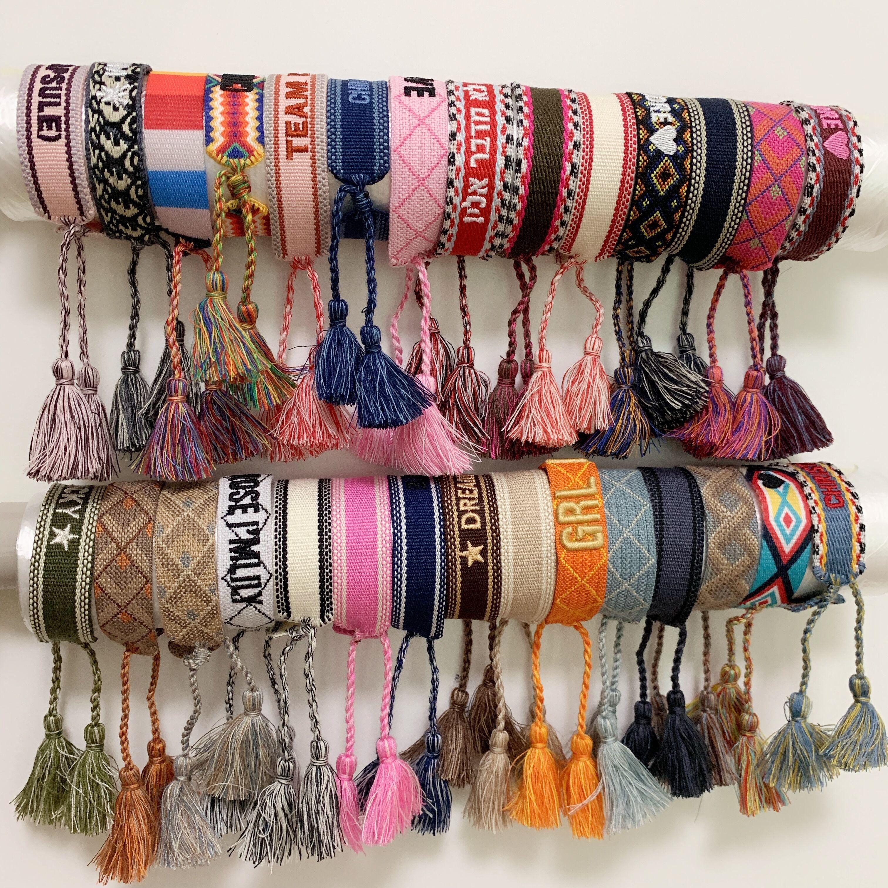 Luxus Stil Seilmaterial Gewebtes Armband mit Nähen Wörtern und Quaste Hand Strap Marke Schmuck für Frauen Geschenk