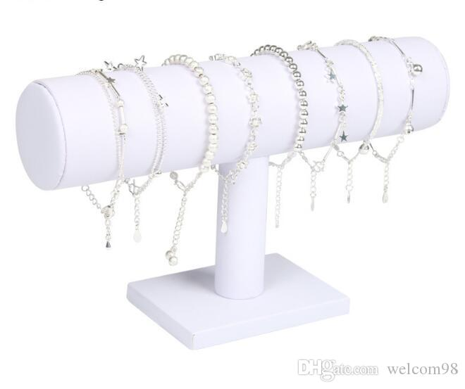 T-bar الأبيض الجلود ووتش سوار مجوهرات التعبئة والتغليف عرض حامل حامل رف للهدايا 1 قطعة / الوحدة DS02 مجانية شيب