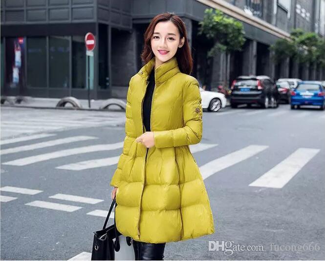 Mode Frauen Winter Daunenjacke warme lange dünne Jacke und Jacke große Schaukel gelb / schwarz Damen Schnee tragen