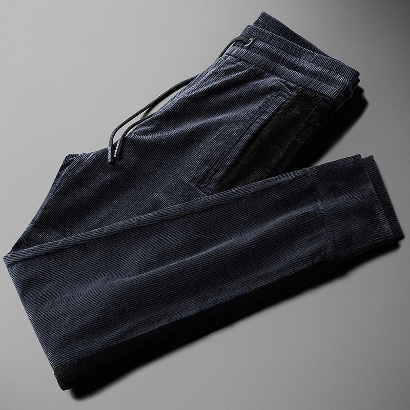 Neuer Corduroy Thick Mens Pants Luxus-elastische Taillen-beiläufige Sport-Mann-Hosen Herbst und Winter Slim Fit Male Hose Plus Size