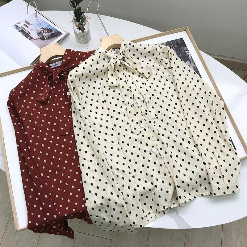 Chemise de femmes de la mode version coréenne de col polka dot arc lâche simple boutonnage